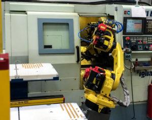 Cellule robotisée de chargement/déchargement de machines outils